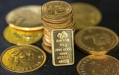 Giá vàng thế giới tăng khi đồng USD xuống giá trong phiên 28 9