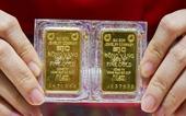Giá vàng trong nước vẫn cao chót vót mặc vàng thế giới lao dốc