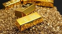 Giá vàng giảm nhẹ trước sức ép của USD